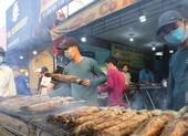 Phố cá lóc nướng Sài Gòn nhộn nhịp ngày vía Thần Tài