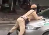 Tài xế taxi tông trung úy CSGT văng lên nắp capo