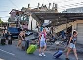 Du khách lũ lượt rời Indonesia sau động đất làm 98 người chết