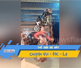 Video: Mặc áo dài, vừa múa vừa đội xe máy lên đầu gây sốt
