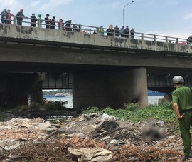 Thi thể cháy đen biến dạng ở chân cầu Đồng Nai