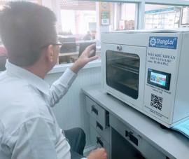 Độc đáo máy khử khuẩn cho tiền made in Việt Nam