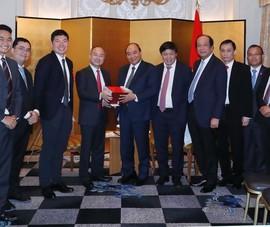 Thủ tướng tiếp tổng giám đốc Tập đoàn SoftBank và Grab