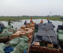 Thấy biên phòng liền bỏ 7 chiếc bè, bơi về phía Trung Quốc