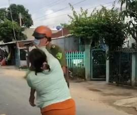 Chồng bị lập biên bản, vợ xông đến chửi và đánh công an