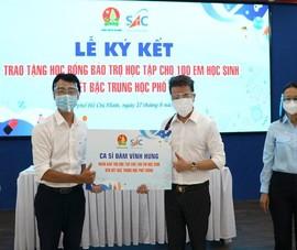 Ca sĩ Đàm Vĩnh Hưng bảo trợ học tập cho 100 trẻ em mồ côi