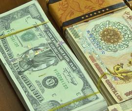 Dùng tờ tiền 1 triệu đô để lừa góp vốn khai thác kho báu tỉ đô