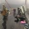 Xe tải húc xe máy lật nghiêng trên cầu Thuận Phước