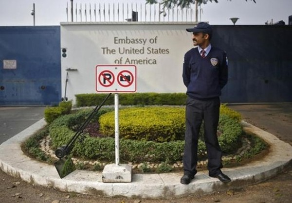 A private security guard stands outside the U.S. embassy in New Delhi December 18, 2013.