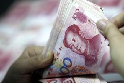 Trung Quốc tiếp tục phá giá đồng Nhân dân tệ. Ảnh: Xinhua