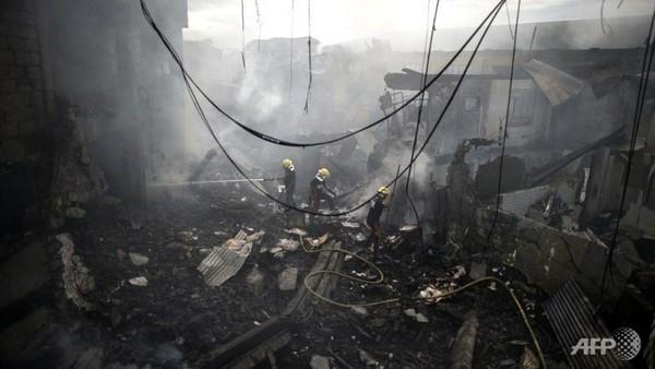 Hiện trường vụ cháy nổ tại chuỗi cửa hàng ở Philippines. Ảnh: AFP