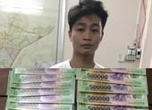 Bắt nhóm làm tiền giả thủ súng và ma túy ở TP.HCM