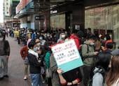 Hàng ngàn người Hong Kong xếp hàng xuyên đêm mua khẩu trang