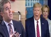 COVID-19: Ông Trump bị chuyên gia 'sửa lưng', báo chí hỏi vặn
