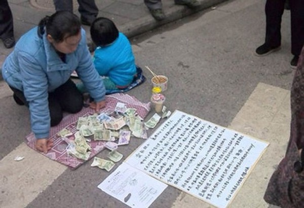 An old woman selling grandson on a street in Wuhan