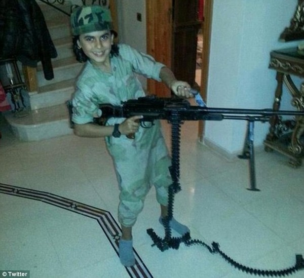 Sickening: ISIS sympathisers took to social media to identify the 10-year-old cub fighter by his alleged nom de guerre Abu Ubaidah. He is said to have died fighting alongside his father in Syria in recent weeks
