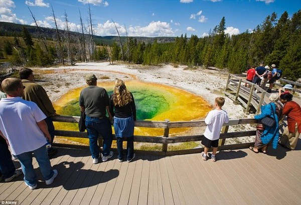 Over three million people enjoy the Yellowstone National Park annually, spans an area of 3,468.4 square miles, comprising lakes, canyons, rivers and mountain ranges