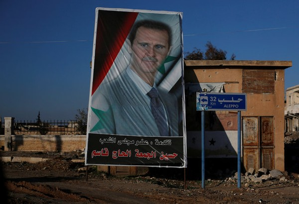 Hình ảnh Tổng thống Syria Bashar al-Assad tại cửa nam vào Aleppo. Ảnh: Ảnh: REUTERS