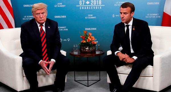 Ông Trump (trái) và ông Macron (phải) gặp bên lề hội nghị G7 tại Canada đầu tháng 6. Ảnh: REUTERS