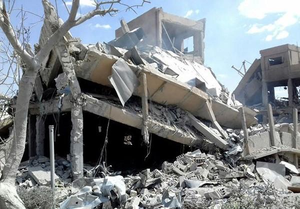 Trung tâm nghiên cứu và phát triển khoa học Barzah của Syria sau khi trúng tên lửa Mỹ-Anh-Pháp nã vào tháng 4-2018. Ảnh: REUTERS