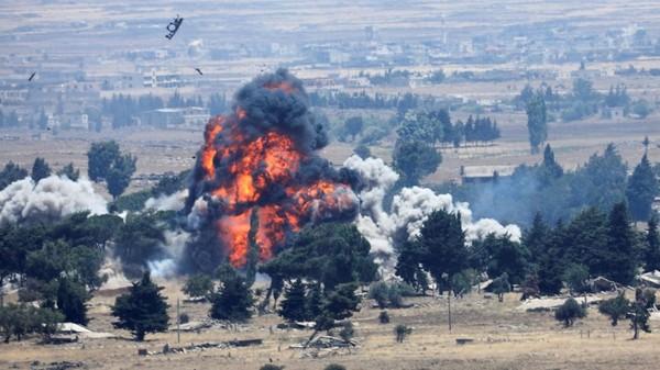 Mỹ đánh bom phá hủy căn cứ gần thị trấn Tell Tamer, tỉnh al-Hasakah trước khi rời đi. Ảnh: REUTERS