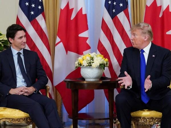 Tổng thống Mỹ Donald Trump (phải) trong cuộc gặp với Thủ tướng Canada Justin Trudeau ở London ngày 3-12. Ảnh: REUTERS