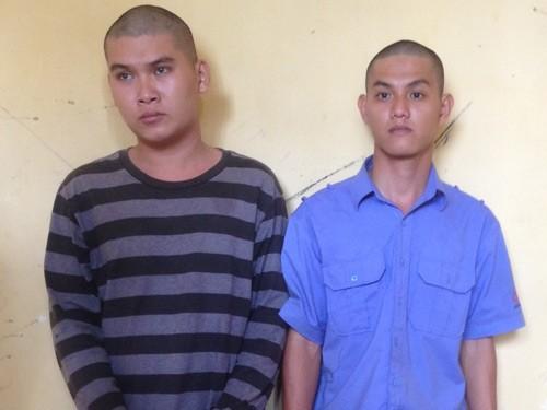 Nguyễn Thanh Phương và Nguyễn Thế Thanh tại cơ quan công an
