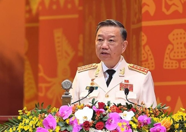 Bộ trưởng Tô Lâm đang trình bày tham luận tại Đại hội XIII. Ảnh: Bộ Công an