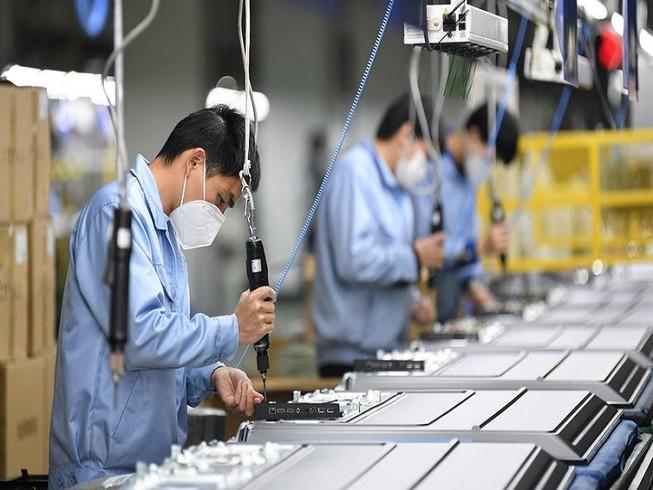 Các doanh nghiệp Trung Quốc quay trở lại sản xuất. Ảnh: TÂN HOA XÃ