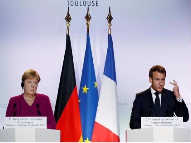 Thủ tướng Đức Angela Merkel và Tổng thống Pháp Emmanuel Macron trong một cuộc họp báo hồi tháng 10-2019. Ảnh: REUTERS