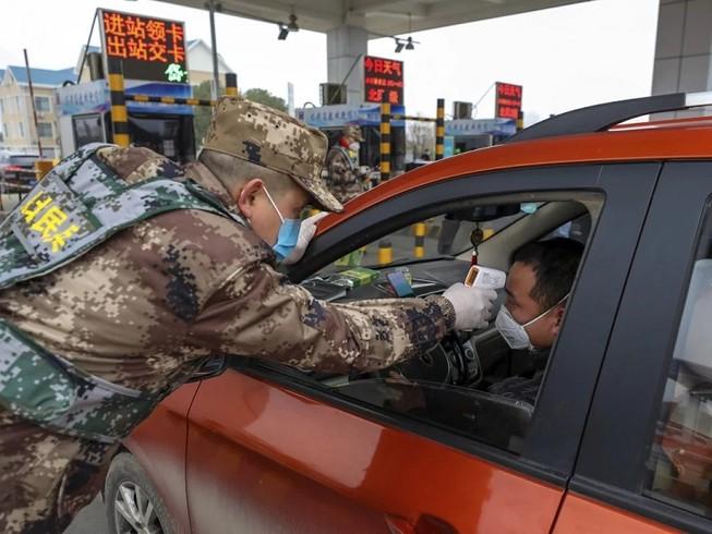 Có thêm 5 địa phương ở Trung Quốc giảm mức độ báo động dịch bệnh COVID-19. Ảnh: SCMP