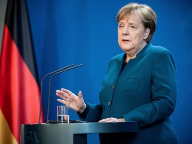 Thủ tướng Đức Angela Merkel trong cuộc họp báo ngày 19-3 về tình hình dịch COVID-19 ở Đức. Ảnh: REUTERS