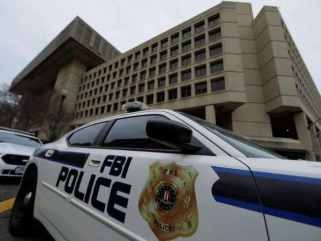 Xe cảnh sát đậu bên ngoài trụ sở FBI ở thủ đô Washington DC, ngày 1-2-2018.