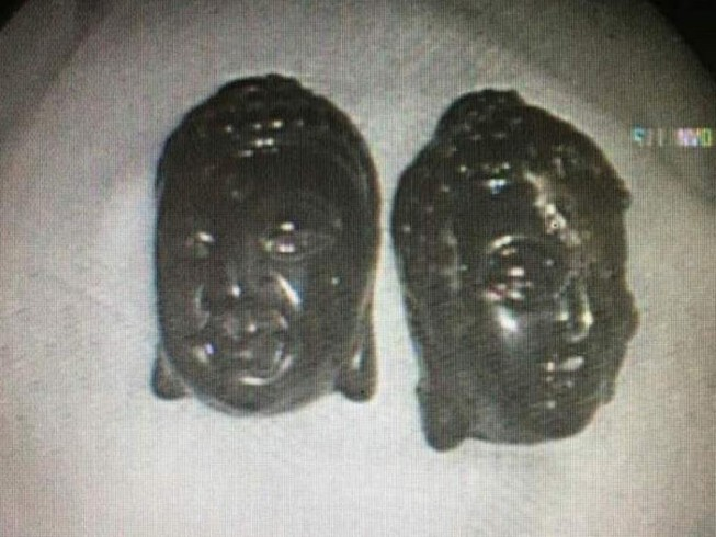 2 tượng Phật 'đi lạc' vô bụng người phụ nữ