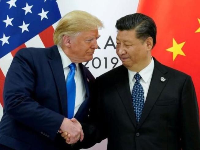 Tổng thống Mỹ Donald Trump (trái) xác nhận sắp cùng Chủ tịch Trung Quốc Tập Cận Bình (phải) ký thỏa thuận giai đoạn 1 của thỏa thuận thương mại. Ảnh: REUTERS
