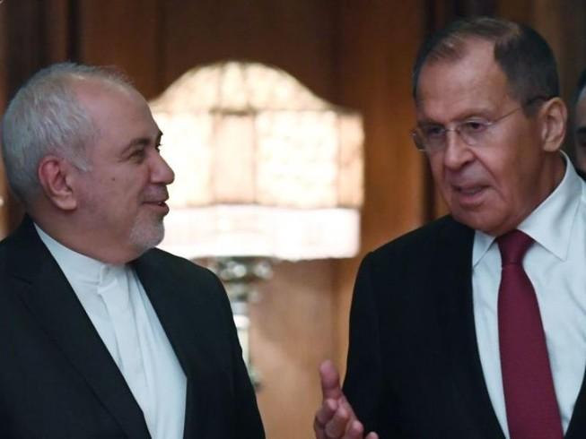 Ngoại trưởng Nga Sergei Lavrov (trái) gặp Ngoại trưởng Iran Mohammad Javad Zarif (phải) tại Moscow ngày 30-12. Ảnh: SPUTNIK