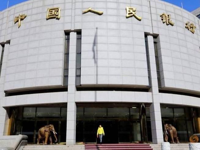 Ngân hàng trung ương Trung Quốc bơm 174 tỉ USD cứu thị trường tài chính. Ảnh: REUTERS
