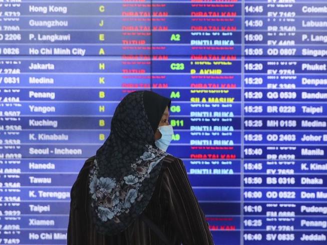 Malaysia cấm du khách nhập cảnh, cấm công dân ra nước ngoài. Ảnh: EPA