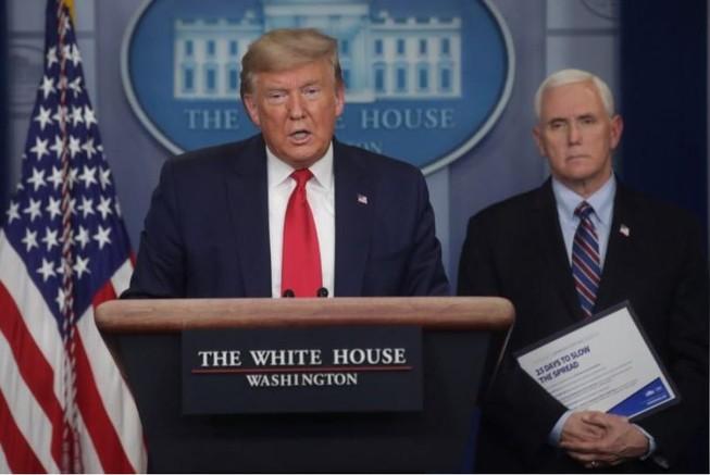 Tổng thống Mỹ Donald Trump họp báo về COVID-19 tại Nhà Trắng ngày 26-3. Ảnh: REUTERS