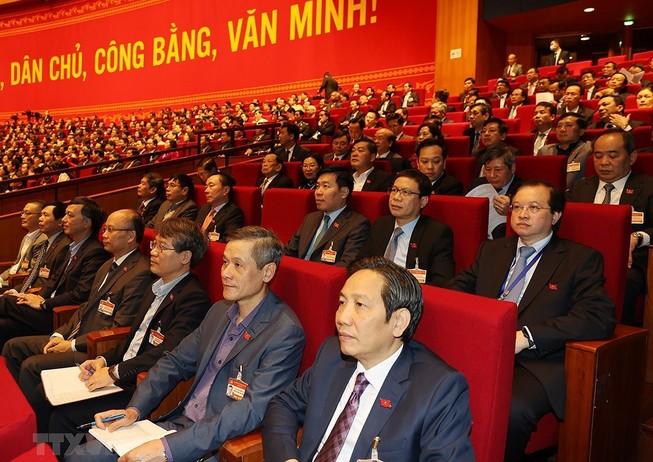Đại biểu dự phiên thảo luận các văn kiện đại hội tại hội trường, sáng 28-1. Ảnh: TTXVN