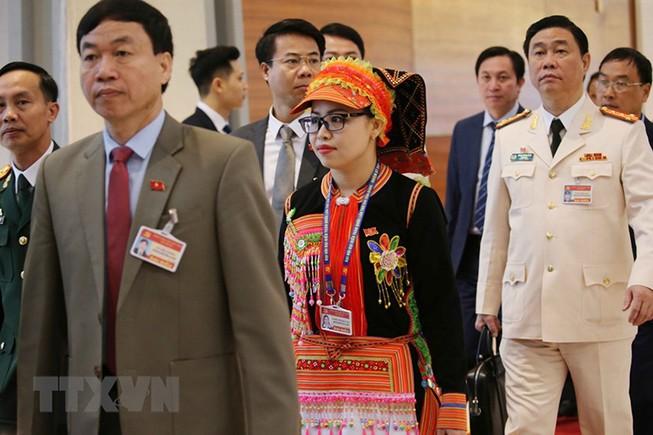 Các đại biểu đến dự ngày làm việc thứ ba Đại hội XIII của Đảng. Ảnh: TTXVN