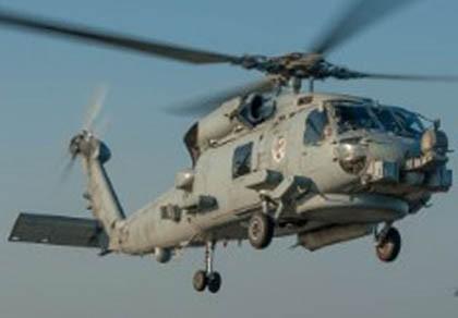 Máy bay Iran lượn sát trực thăng vũ trang Mỹ