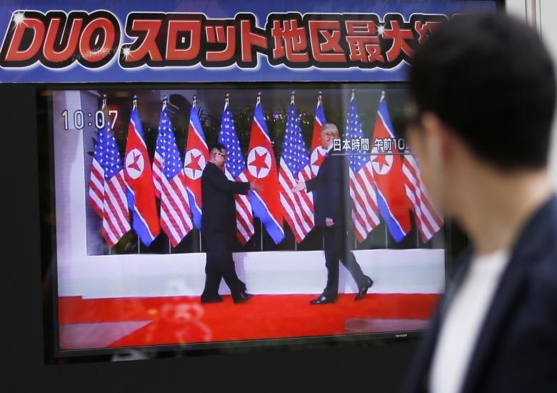 Phản ứng của người dân trước cái bắt tay Trump-Kim - ảnh 7