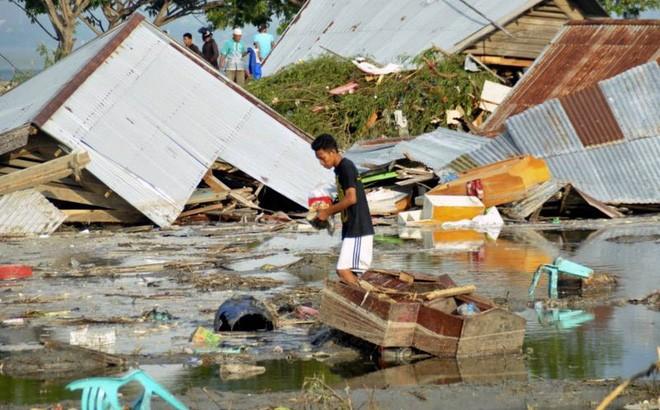 Quốc tế chung tay hỗ trợ nạn nhân thảm họa sóng thần - ảnh 2