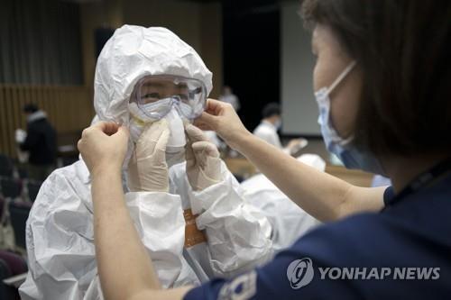Hàn Quốc đã có gần 1.800 người nhiễm, thêm ca tử vong  - ảnh 1