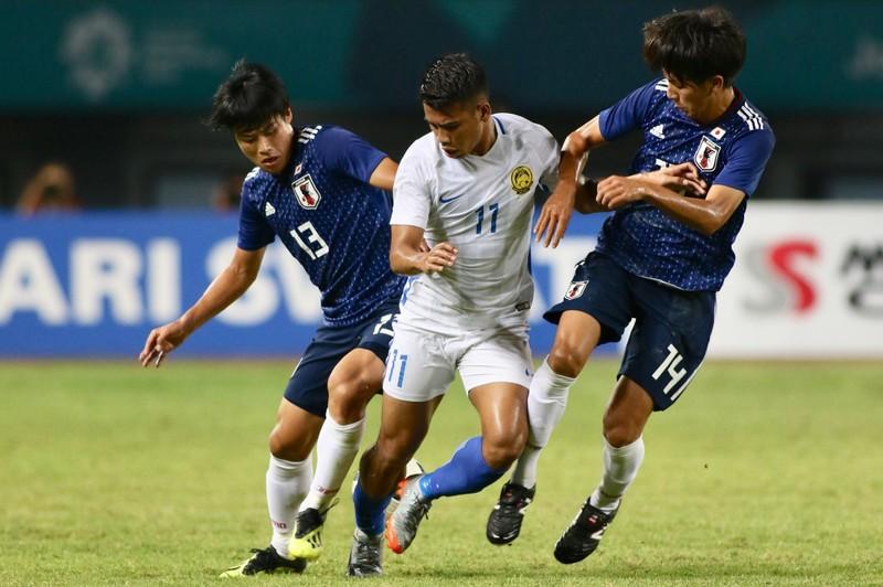 Olympic Malaysia bị Nhật Bản loại theo cách đau đớn - ảnh 1