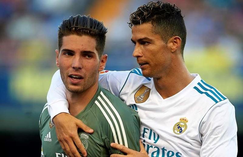 Vừa trở lại Real, Zidane đã dùng 'ô dù' che con trai - ảnh 1