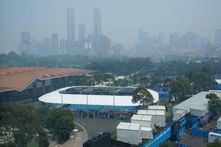 VĐV ngất xỉu khi thi đấu vì khói bụi cháy rừng ở Úc - ảnh 3