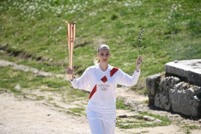 Olympic 2020 bắt đầu từ huyền thoại bị 'toang' vì COVID-19 - ảnh 12