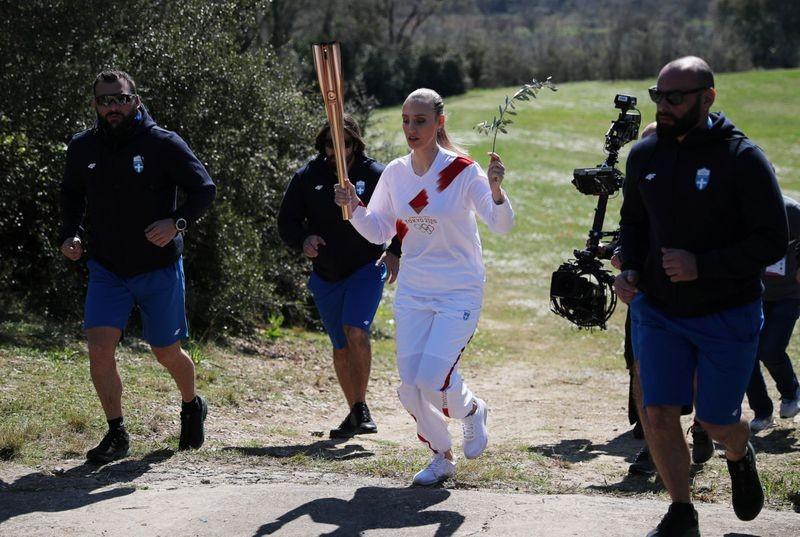 Olympic 2020 bắt đầu từ huyền thoại bị 'toang' vì COVID-19 - ảnh 9